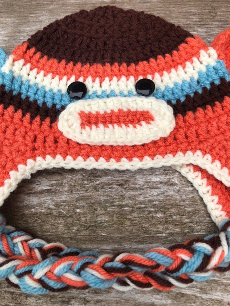 Crochet Monkey Hat with Ear Flaps Baby Hat Photo Prop 7 12 x 5 12 Braid 10 inches in length Button Black Eyes