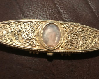 Vintage Estée Lauder solid perfume compact with scroll work and picture