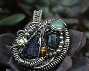 Reiki infused sterling silver wire wrap pendant