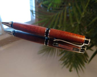 """Black Walnut """"Cigar"""" style pen with chrome accents."""