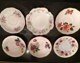 Set of six various tea saucers