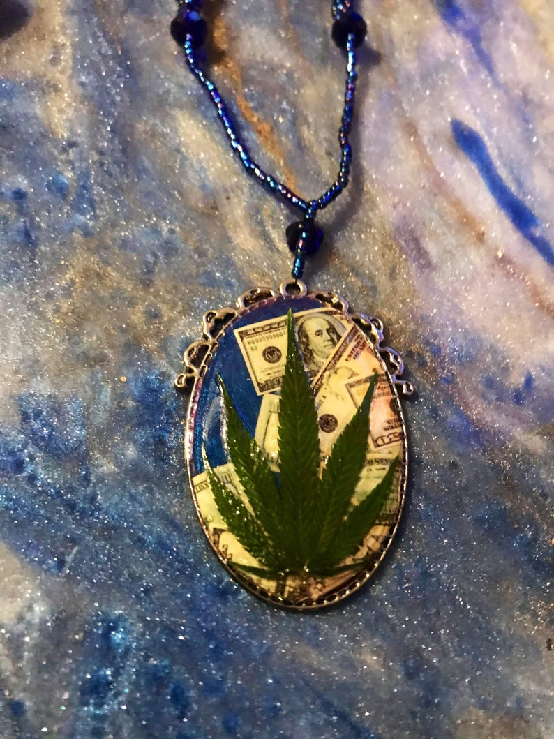Money necklace with real marijuana leaf on 3 strand blue iridescent bead necklace with crystal accent beads