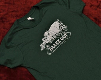 Green T-shirt with concrete truck design