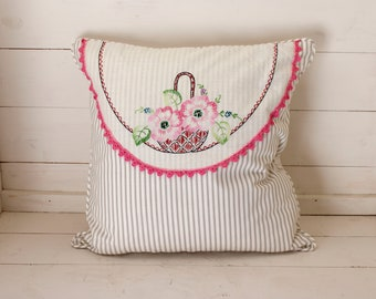 Doily on pillow with white and grey ticks