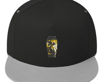 61c4a6285f4 Embroidered snapback hat featuring original design.