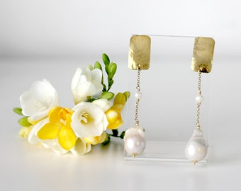 Pendants in silver bathed in gold and baroque pearl.