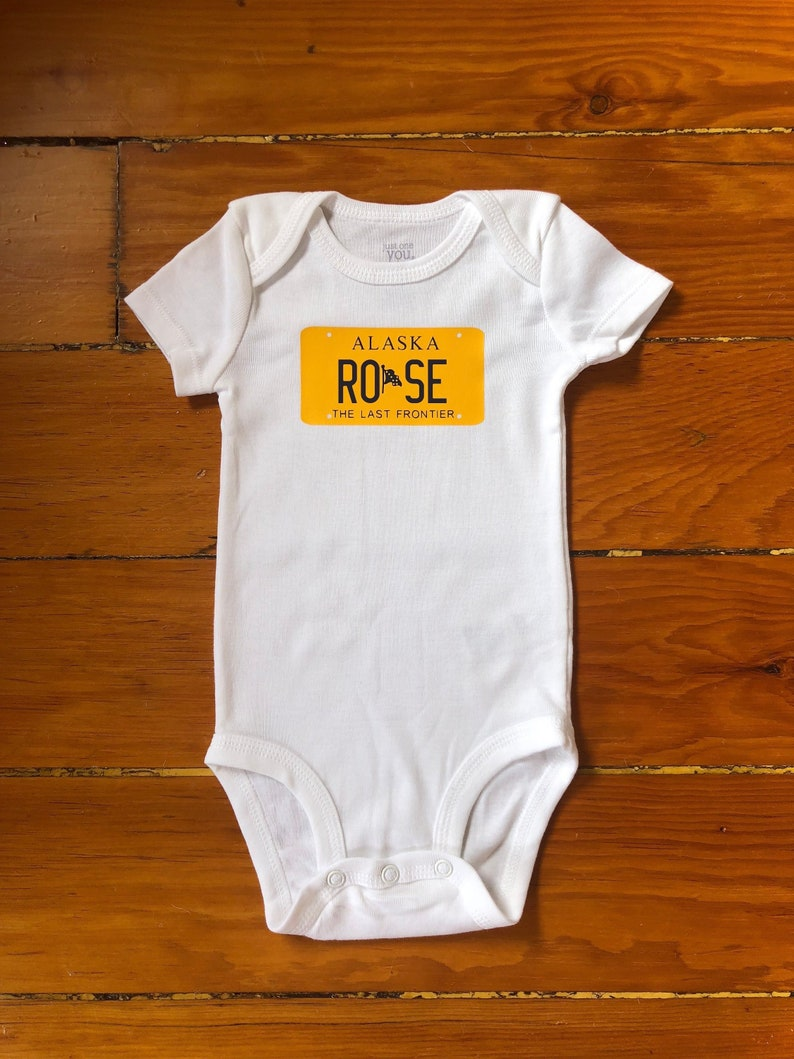 View My Shop For All 50 States Alaska License Plate Art Baby Bodysuit in Gift Wrap Personalized
