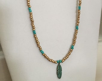 Necklace with feather charm