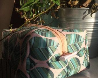 Geometric leaf print pouch.