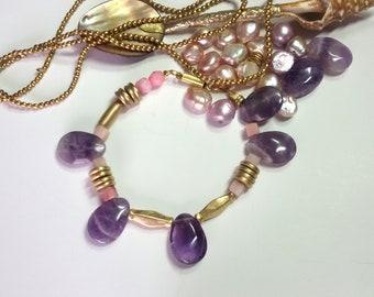 Brass bracelet with amethyst in teardrop and pink opal