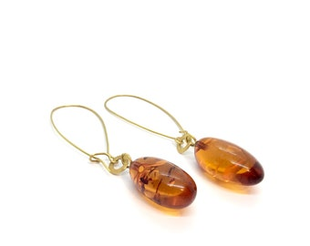 Gold earrings with amber