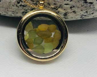 Memory locket with pieces of seahams historic seaglass in shades of blue and green