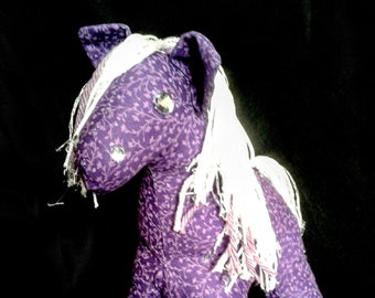 Purple floral stuffed pony
