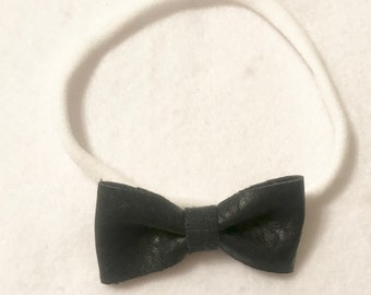 Mini black leather bow