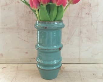 Four Ring Round Blue Vase.
