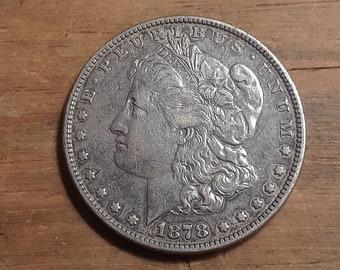 1878. 7 Tail Feathers Morgan Silver Dollar Very Good grade.
