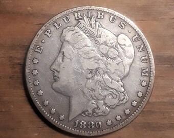 1880 O Morgan Silver Dollar Very Good grade.