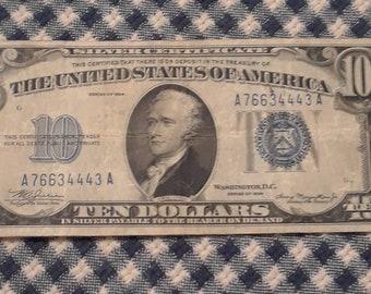1934 10  dollar Silver Certificate blue seal bill Mint Error Off Center Reverse Printing. See left side of reverse.