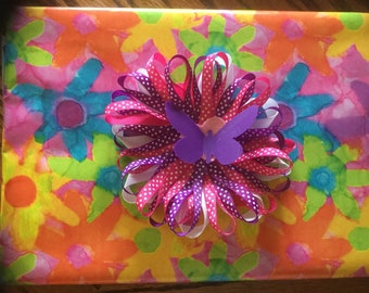Purple and pink polka dot gift wrap bow
