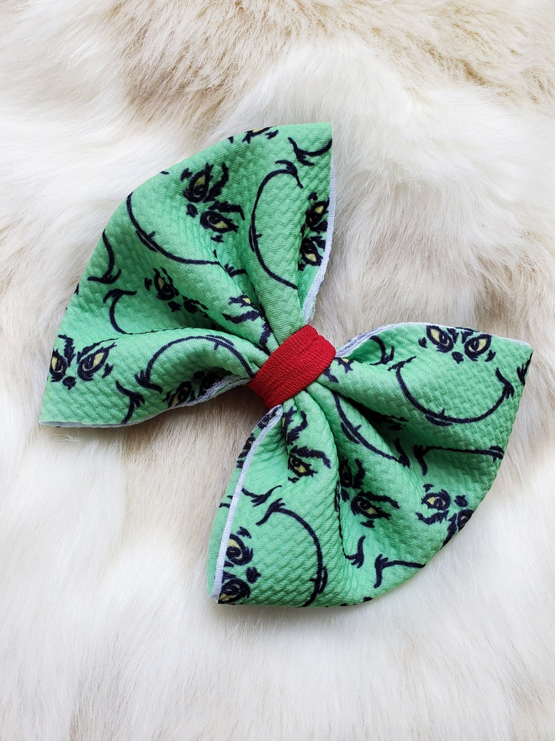 Grinchy man Christmas headband bow with or without Grinch heart.