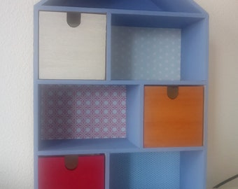 Handmade children's bookshelf with a small house