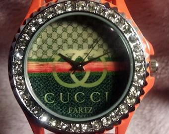 710a94660b66 Cucci Fartz Orange Stoned Bezel Case with Orange Silcone Band Running