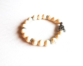 White bracelet with a buddha pendant