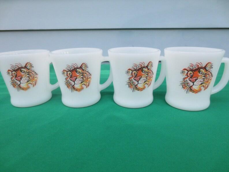 c2139fb080d Set of Four Fire King Esso Exxon Tiger Cups | Etsy