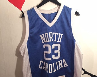 eea1a1ab6 1990s Vintage North Carolina Tarheels Jordan Jersey - 90s Michael Jordan  NCAA Basketball Team Merchandise T-Shirt
