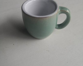 Espresso cup handmade on the potter's wheel. Ceramic design. Handmade espresso cup. Wheel thrown. Green and white glaze.