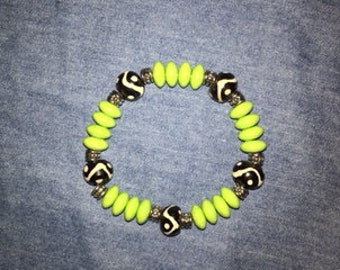 Funky Boho stretch bracelet of lime green and brown ceramic beads with silver accents
