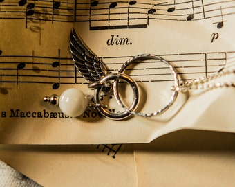 Angel wing pendant with mother of pearl charm