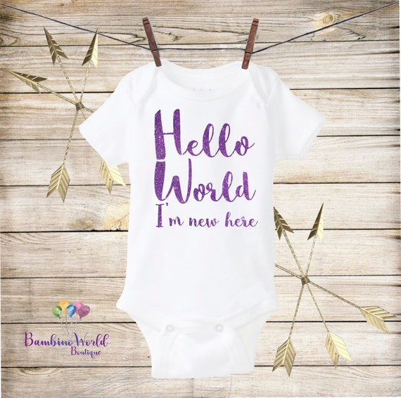 5b3f2f767 Hello World Baby Onesie®I m new Here Purple Glitter