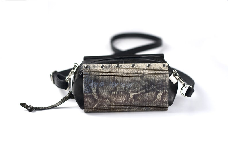 Handcrafted pochette made of hand-painted wood and leather Snake skin