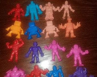 Lot of various colored M.U.S.C.L.E. men figures 1980s muscle men