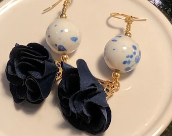 Beautiful Ceramic Blue and White Splatter rounds with Navy blue and gold Tassels Jesse James beads on Gold plated Leverback earring wire