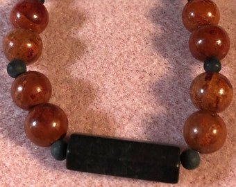 Mens 10mm Brecciated Red Jasper and 27mm x 12mm Black Onyx Faceted Tube Stretch Mans Bracelet  made to order