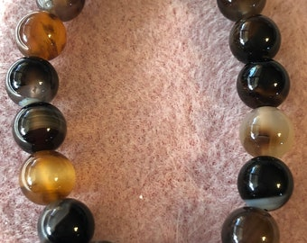 10 mm Black and Brown Striped Agate Rounds Stretch Bracelet fits your choice of size