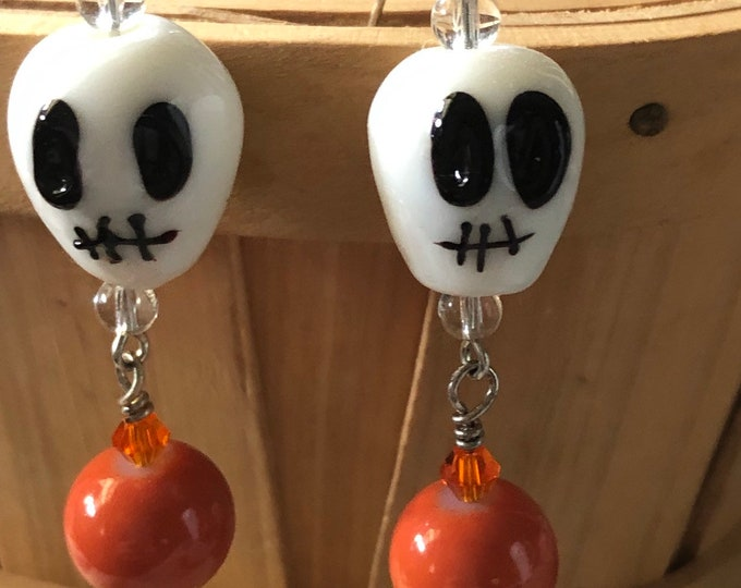 glass skull earrings for day of the dead or halloween!! Dangle drop on sterling silver lever backs