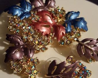 70's Aurora borealis demi parure enamel leaf and rhinestone flower, grape cluster goldtone metal brooch pin & earring set statement jewelry