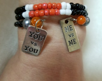 """22"""" Orange/Blacl/White Seed Memory Bracelet with Charms"""