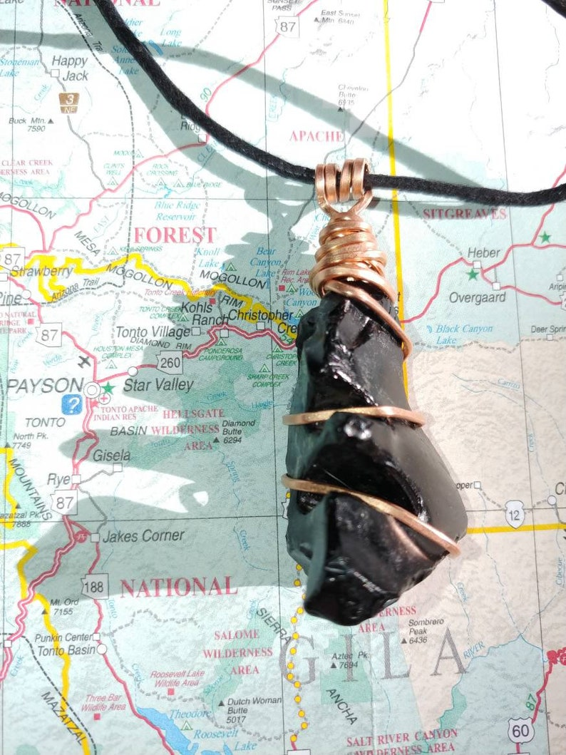 Natural obsidian totem in hand-hammered copper