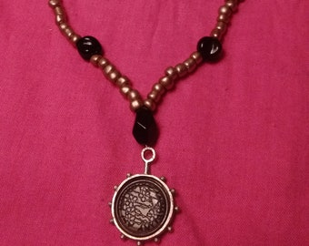 Studded Wheel Pendant with Beaded Necklace