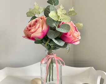 Small hand tied arrangement of faux peach/ pink roses