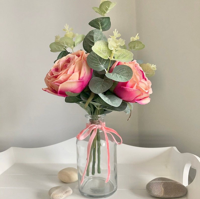Small hand tied arrangement of faux peach/ pink roses image 0
