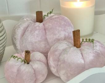 Three pale pink crushed velvet pumpkins