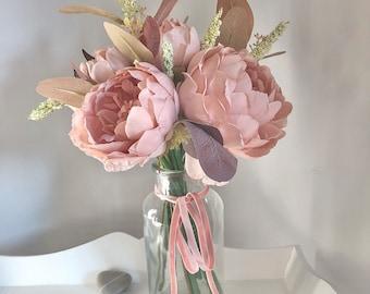 Medium sized hand tied arrangement of blush pink peonies