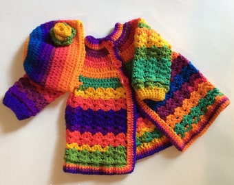 Bright colored baby/toddler girl winter sweater and flowered hat. Girl/Sweater/Hat