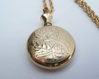 Golden Perfume bottle pendant necklace Vintage jewelry good condition 1970's