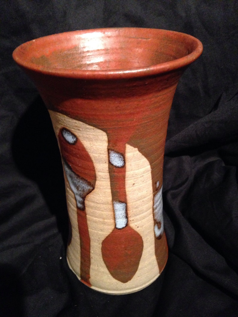 Hand thrown stoneware vase with drip glaze and a spoon motif